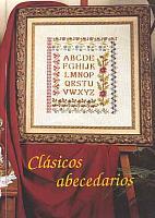 sampler punto croce classico con bordi floreali (1)